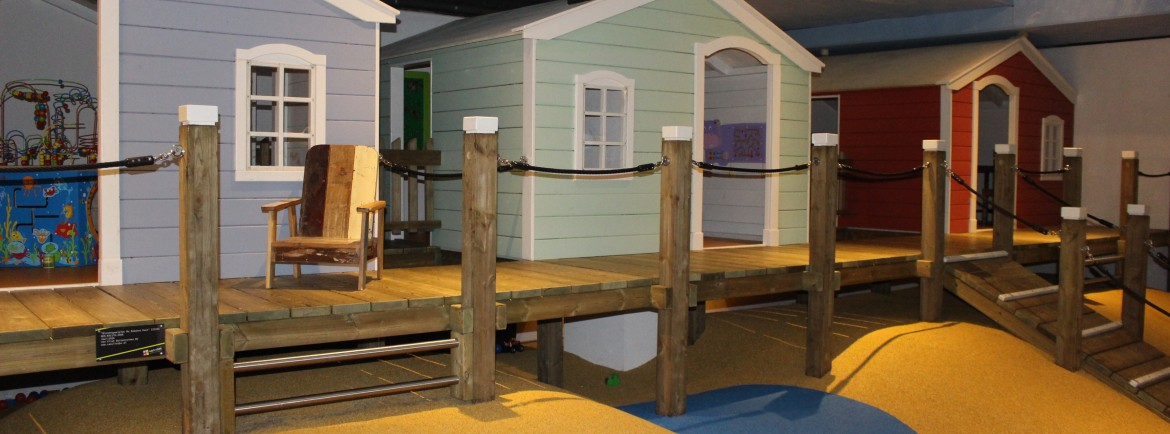 The beach houses in the indoor playground...